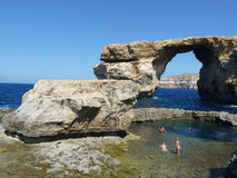 Azure Blue Window in Gozo Malta showing Rock Formation. Dwejra Bay. Deep blue hole Stock Image