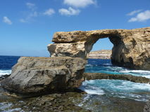 Azure Blue Window in Gozo Malta showing Rock Formation. Dwejra Bay. Deep blue hole Stock Photography