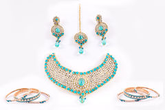 Azure Bridal Jewlery Set. Indian Jewlery Set with earing, head adorement bracelets and neckace on white background stock photos