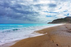 The azure Caribbean sea in cloudy weather. Empty carribean beach in storm Stock Images