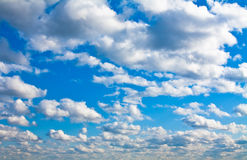 Azure Cloudscape Sky. Azure sky with scattered fluffy clouds Background Stock Photos
