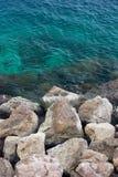 Azure coast. Azure blue water of azure coast with rocks Stock Images