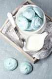 Azure homemade meringue cookies and cup of milk Royalty Free Stock Photo