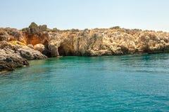 Azure lagoon and stone rocks. Turkish beach in Kemer. stock photos