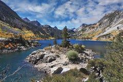 Azure lake in the autumn mountains Stock Photos