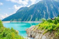 Azure lake with peaks of the Alps, Austria Stock Photo