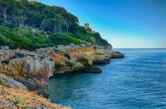 Azure mediterranean sea and rocky coast near Mora Tarragona, Spain Royalty Free Stock Photos