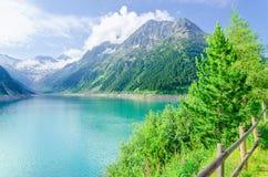 Azure mountain lake and high Alpine peaks, Austria Royalty Free Stock Image