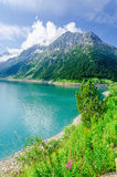 Azure mountain lake and high Alpine peaks, Austria Royalty Free Stock Photography