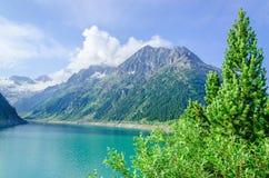 Azure mountain lake and high Alpine peaks, Austria Royalty Free Stock Photos