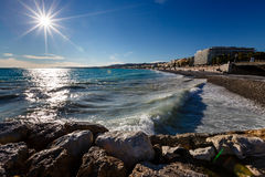 Azure Sea and Beautiful Beach in Nice Royalty Free Stock Images