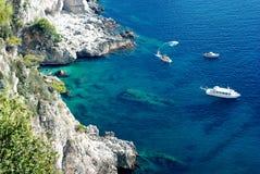 Azure sea at Capri island. Aerial view of Capri island with boats and beautiful azure blue sea Stock Images
