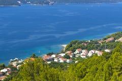 Azure sea coast with the town Stock Photos