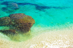 Azure sea of Crete. Underwater rocks in the clear turquoise water. top view Stock Photos