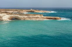 Azure sea and grotts of the Maltese coastline. Malta island. Stock Images
