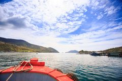 Azure Sea Hills Sky from Boat Deck Red Nose Royalty Free Stock Photography