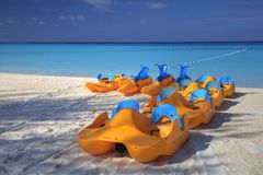 Floating boat toys on a Caribbean beach. stock image