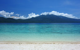 Azure sea. View of azure sea with beach and volcano Hiboc Hiboc. Camiguin Island, Philippines Royalty Free Stock Images
