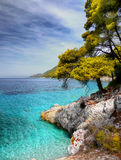 Azure Sea water Coast. Rocky coast and azure sea water Royalty Free Stock Photo
