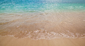 Azure sea waves with yellow sand beach. Bright sun light and beautiful sea. Stock Photography