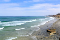 Azure Shore of Solana Beach, CA. Azure Pacific Ocean Waters and Rock Cliffs , Solana Beach, CA Stock Images