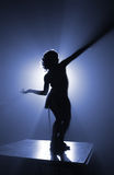 Azure silhouette. Silhouette of party dancer in azure light Stock Image