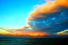 Amazing clouds over the sea during sunset. Azure sky with amazing clouds over the Adriatic sea during a very colorful sunset stock photography