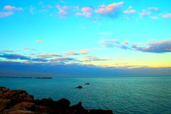 Azure sky over the blue sea stock photography