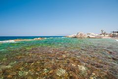 Azure surface of the water, clear water on the shore royalty free stock image