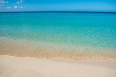Azure turquoise calm sea, clear blue sky, sandy beach and flat horizon Royalty Free Stock Photos