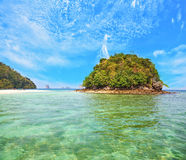 . Azure warm water and white sand. The round green island in Thailand, April. The wonderful beach and spectacular island. Azure warm water and white sand Stock Image