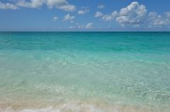 Azure water and blue sky on Grace Bay Beach in the Turks and Caicos Royalty Free Stock Images