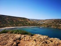 Azure water of Ghajn Tuffieha Bay at Malta Royalty Free Stock Images