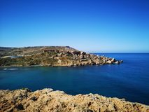 Azure water of Ghajn Tuffieha Bay at Malta with cliffs. EU Royalty Free Stock Images