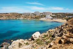 Azure water of Ghajn Tuffieha with Golden Bay Beach Malta Royalty Free Stock Image