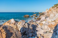 Aegean Sea, Skiathos, Greece. landscape. Azure waters of the aegean sea on the island of Skiathos, Greece. Rocky shores royalty free stock photography