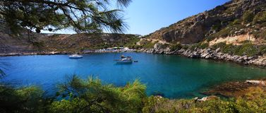 Azure waters at a small Bay in Rhodes Greece Stock Photo