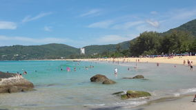 Azure waves rolled on the sand of Karon Beach. PHUKET, THAILAND - NOVEMBER 19, 2015: Waves rolled on the sand of Karon Beach, Phuket, Thailand stock video footage