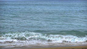 Azure waves rolled on the sand of Mai Khao Beach stock video