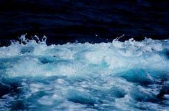 Azure and white boat wake seafoam Royalty Free Stock Photo