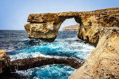 The Azure Window at Dwejra on Gozo island. Waves against cliffs at The Azure Window at Dwejra on Gozo island, Malta Stock Photography