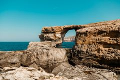 Azure Window, famous stone arch of Gozo island in the sun in summer, Malta Royalty Free Stock Image