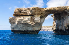 Azure Window in Gozo in blue summer waters. Natural arch limestone rock in Dwejra Bay in Malta in the Mediterranean Sea Stock Photos