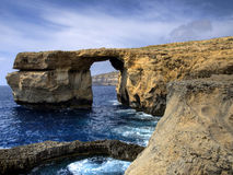 Azure Window, Gozo Island. The Azure Window, a natural arch in the Maltese island of Gozo featuring a table-like rock over the sea. The Inland Sea, Gozo, and Stock Image