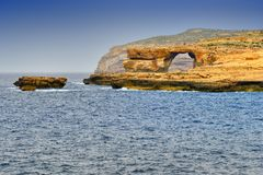 Azure window, Gozo island landscape, Malta. Rock known as Azure window, the Dwajra Bay, on the coast of Gozo island, Malta Royalty Free Stock Photography