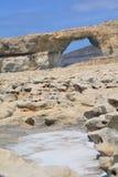 Azure Window on Gozo Island. Gozo Island - the limestone rocks with salt crystals in pool Stock Photography