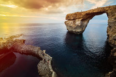 Azure window, Gozo island, Malta. Azure Window, natural arch, famous landmark and popular tourist spot, on Gozo island, Malta, Mediterranean, at dramatic sunset Stock Photo