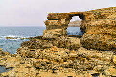 Azure window, Gozo island, Malta. Rock known as Azure window, the Dwajra Bay, on the coast of Gozo island, Malta Royalty Free Stock Images