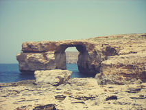 Azure Window on Gozo island, Malta, on a sunny summer day; faded, retro style Royalty Free Stock Photos
