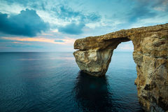 Azure Window, Gozo, Malta. Azure Window, natural arch on Gozo island, with blue sky and clouds Stock Photo